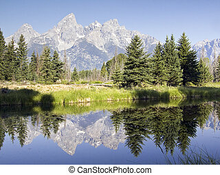 Mountains of the Teton Range reflected in the waters of the Snake River at Schwabacher's Landing, Grand Teton National Park, Wyoming