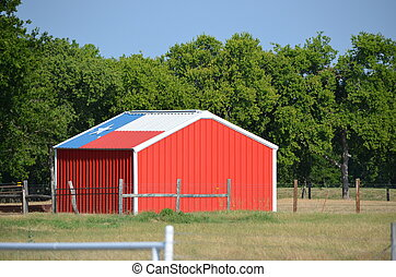 Red shed with Texas flag on the roof