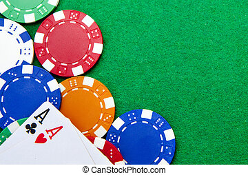 Texas holdem pocket aces on casino table with copy space and chips