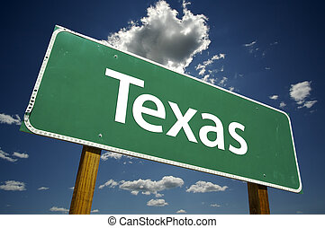 Texas Road Sign with dramatic clouds and sky.