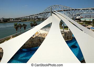 Texas State Aquarium and the Harbor bridge in Corpus...