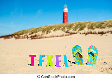 Texel Dutch wadden island with lighthouse and flip flops