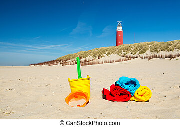 Texel Dutch wadden island with lighthouse and toys
