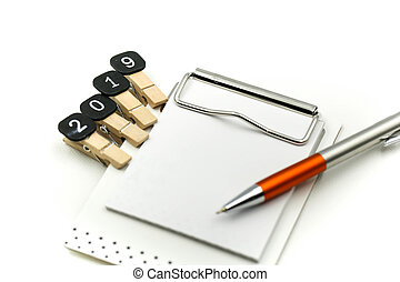 Text 2019 goals on notebook with pen on white background, New year Concept