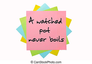 """text """"A watched pot never boils"""" written by hand font on bunch of colored sticky notes"""