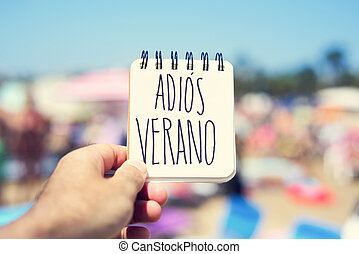 text adios verano, good bye summer in spanish - closeup of a...