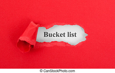 Text appearing behind torn red envelop - Bucket list