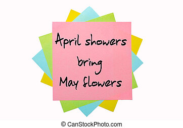 "text ""April showers bring May flowers"" written by hand font on bunch of colored sticky notes"