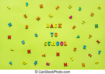 Text Back to school of multi-colored letters, scattered letters