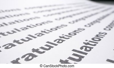 text background. word congratulation printed on a sheet of paper with a list.