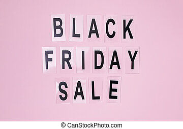 Text Black Friday Sale on pink background