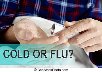 text cold or flu and man about to take a medicine