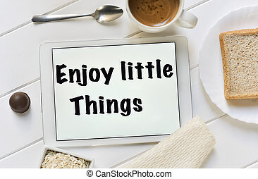 text enjoy little things in a tablet