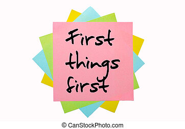 "text ""  First things first "" written by hand font on bunch of colored sticky notes"