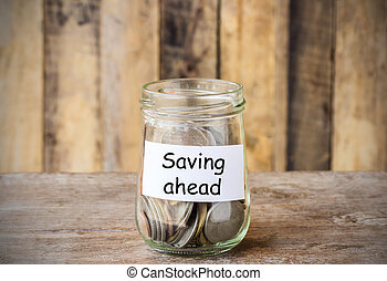 Text for Saving ahead, concept money in the glass