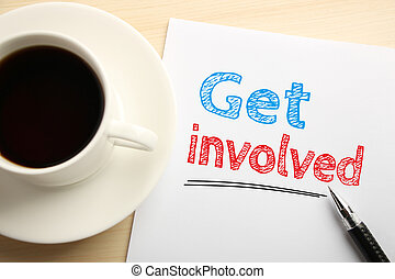 Get involved - Text Get involved written on the white paper ...