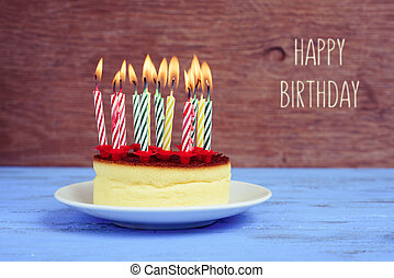 text happy birthday and cheesecake with lighted candles