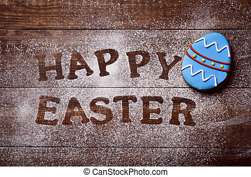 text happy easter and decorated egg