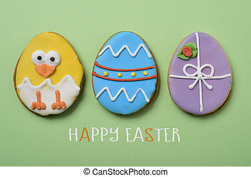 text happy easter, chick and decorated eggs