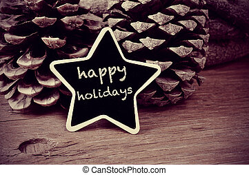 text happy holidays in a star-shaped blackboard, in black...