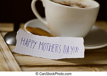 text happy mothers day in a piece of paper