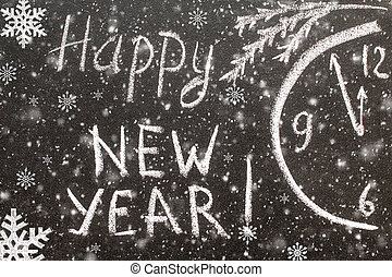 text Happy New Year 2017 on chalkboard