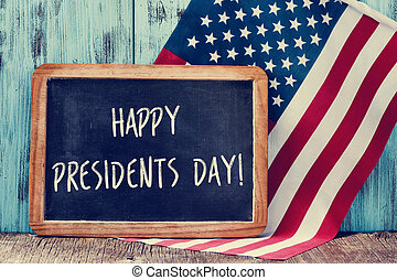 text happy presidents day in a chalkboard and the flag of...