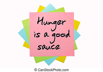 """text """" Hunger is a good sauce """" written by hand font on bunch of colored sticky notes"""