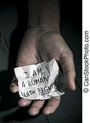 text I am a human with rights in a piece of paper - closeup...