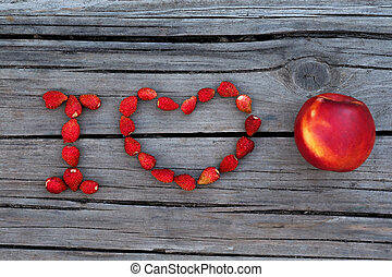 Text I love nectarine or fruits on wooden gray background....