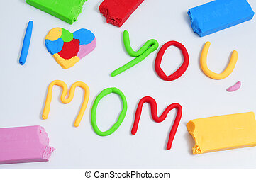 text I love you mom, made in modeling clay