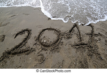 text in the year 2017 on the sand of the sea waiting to be...