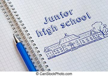 Text Junior high school handwritten on sheet of notebook