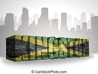 text kingston with national flag of jamaica near abstract silhouette of the city