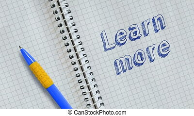 Learn more - Text Learn more handwritten on sheet of...
