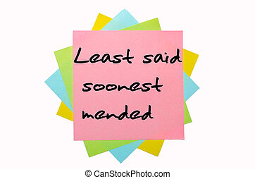 "text ""Least said soonest mended"" written by hand font on bunch of colored sticky notes"