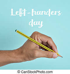 text left-handers day and the hand of a lefty - the text...
