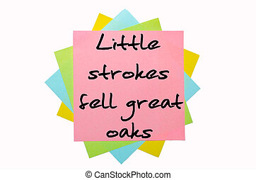 "text ""Little strokes fell great oaks"" written by hand font on bunch of colored sticky notes"