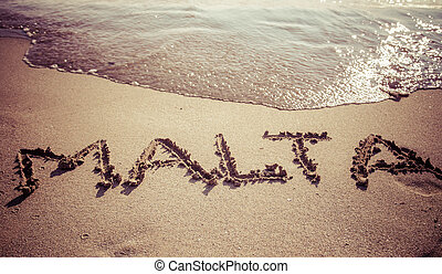 Text Malta on the beach