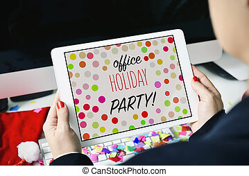 text office holiday party in a tablet - closeup of a young ...