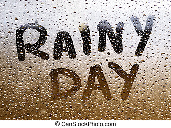 """Text """"RAINY DAY"""" written in a crystal with many drops."""