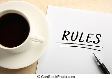 Rules - Text Rules written on the white paper with coffee...