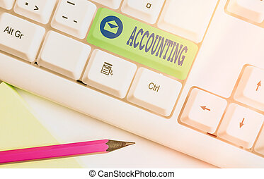 Text sign showing Accounting. Conceptual photo the documentation of financial transactions relating to a company Different colored keyboard key with accessories arranged on empty copy space.