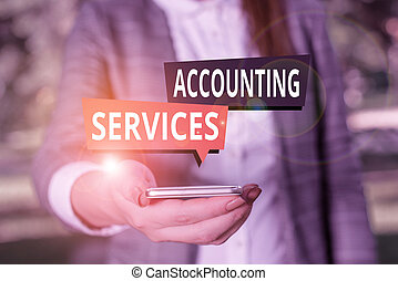Text sign showing Accounting Services. Conceptual photo analyze financial transactions of a business or a demonstrating Woman in grey suites holds mobile phone.