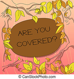 Text sign showing Are You Covered. Conceptual photo Asking about how medications are covered by your plan Tree Branches Scattered with Leaves Surrounding Blank Color Text Space.