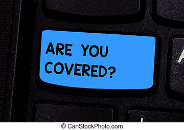 Text sign showing Are You Covered. Conceptual photo Asking about how medications are covered by your plan Keyboard key Intention to create computer message pressing keypad idea.