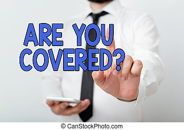 Text sign showing Are You Covered Question. Conceptual photo asking if they had insurance in work or life Model with pointing hand finger symbolizing navigation progress growth.