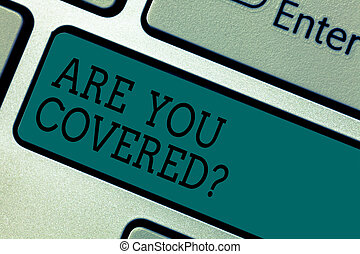 Text sign showing Are You Coveredquestion. Conceptual photo asking about you insurance health statement Keyboard key Intention to create computer message pressing keypad idea.