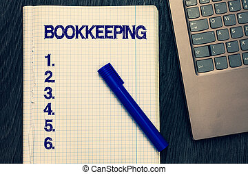 Text sign showing Bookkeeping. Conceptual photo Keeping records of the financial affairs on a business Open notebook squared page black marker computer keyboard wooden background.