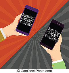 Text sign showing Brainstorm Community Management. Conceptual photo Organizing and suggesting business strategy Two Hu analysis Hands Each Holding Blank Smartphone Mobile on Sunburst photo.